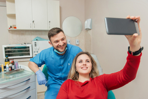 smiling-physician-and-patient